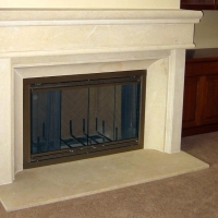 Custom Limestone Fireplace Surround by Stone Center, Inc