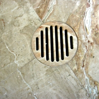 Travertine shower drain waterjet
