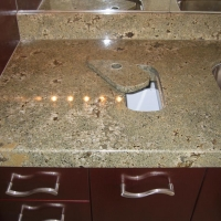 Granite Counter Detail Garbage Cutout by Stone Center, Inc
