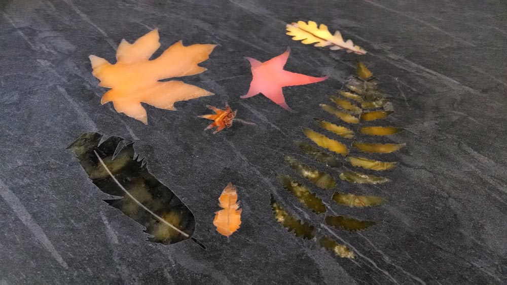 Waterjet Onyx Leaves in Soapstone by Stone Center, Inc
