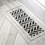 waterjet cut heat register cover in herringbone pattern