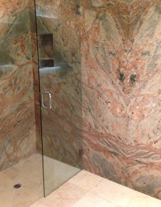 Bookmatch slab shower in granite by stone center inc pdx